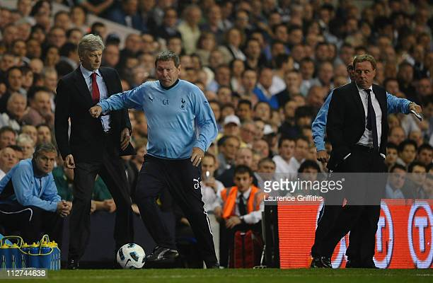 Spurs coach Clive Allen pushes Arsenal manager Arsene Wenger out of the way during the Barclays Premier League match between Tottenham Hotspur and...