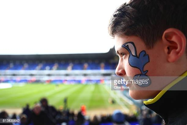 Spurs fan enjoys the pre match atmosphere during the Barclays Premier League match between Tottenham Hotspur and Swansea City at White Hart Lane on...
