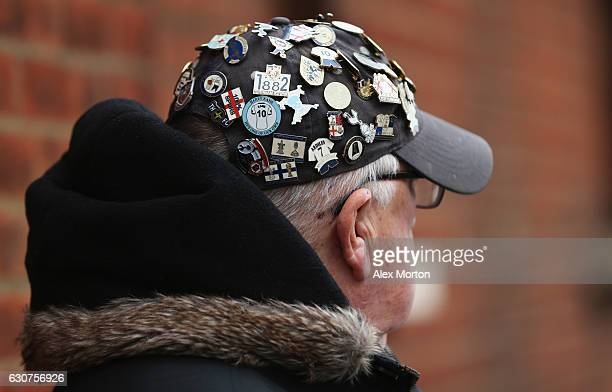 Spurs fan shows off his pin badge collection prior to the Premier League match between Watford and Tottenham Hotspur at Vicarage Road on January 1...