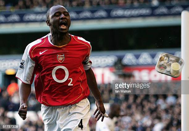 Spurs fan throws a carton of drinks at Patrick Vieira of Arsenal as he celebrates his goal during the Barclays Premiership match between Tottenham...