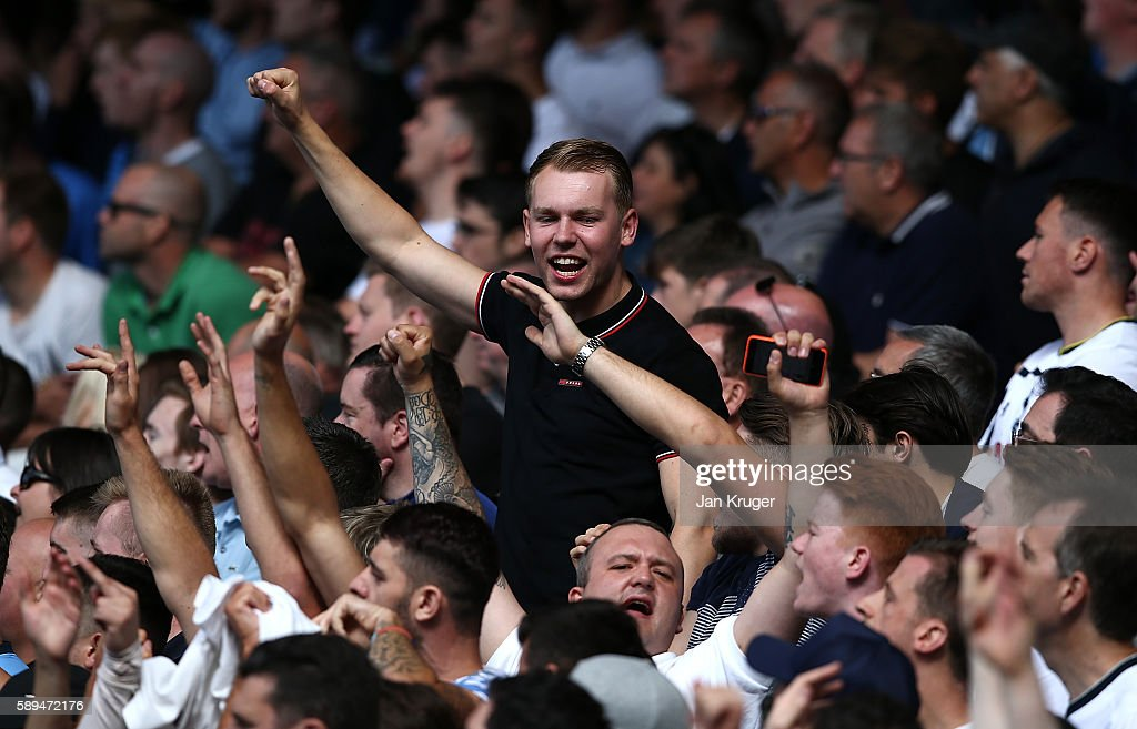 Spurs fans celebrate during the Premier League match between Everton and Tottenham Hotspur at Goodison Park on August 13, 2016 in Liverpool, England.