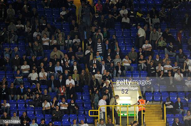 Spurs fans leave the ground before the end of extra time as their team heads towards a 41 defeat during the Carling Cup third round match between...