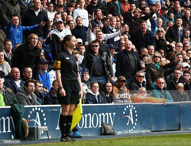 Spurs fans shoyut appeals to assitant referee Sian Massey in action during the Barclays Premier League match between Tottenham Hotspur and Everton at...