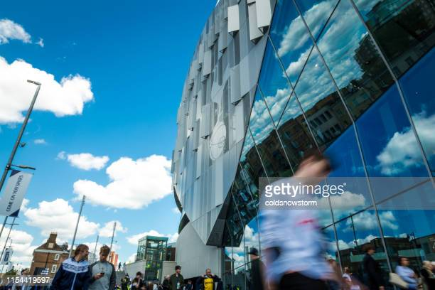 spurs football supporters outside new tottenham hotspur stadium on match day, london, uk - sports event stock pictures, royalty-free photos & images