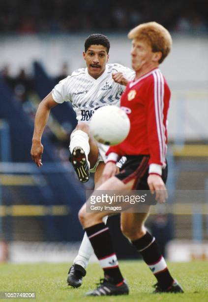 Spurs full back Chris Hughton clears the ball past the advances of Manchester United player Gordon Strachan during a First Division match at White...