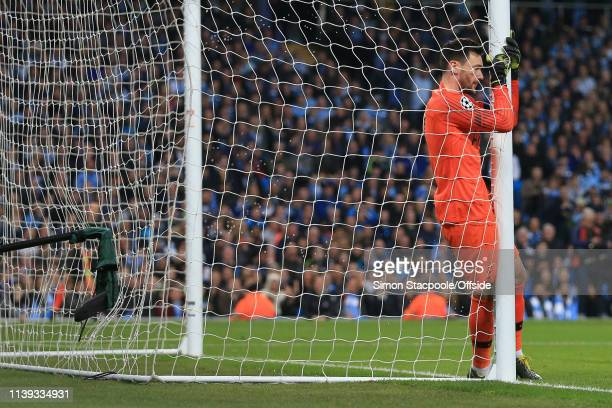 Spurs goalkeeper Hugo Lloris wraps himself around the goalpost and net during the UEFA Champions League Quarter Final second leg match between...