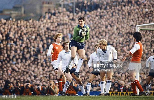 Spurs goalkeeper Milija Aleksic claims a cross watched by Arsenal players Willie Young and Frank Stapleton alongside Spurs players Gerry Armstrong...