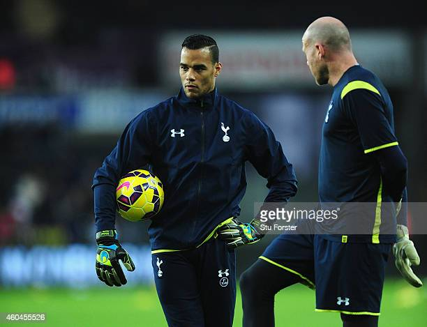 Spurs goalkeepers Brad Friedel and former Swansea player Michel Vorm look on before the Barclays Premier League match between Swansea City and...