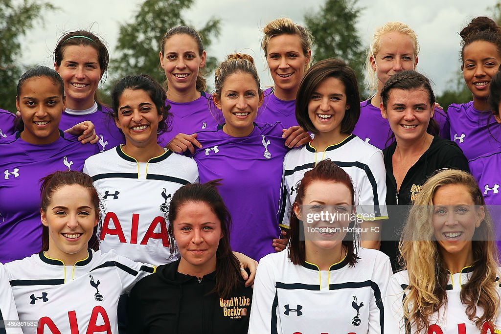 Spurs Ladies team pose with members of the musical 'Bend it Like Beckham' during a training session where Tottenham Hotspur Ladies Coach the Cast of 'Bend it Like Beckham' on August 27, 2015 in Enfield, England.