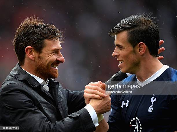 Spurs manager Andre VillasBoas congratulates Gareth Bale following their team's 21 victory during the Barclays Premier League match between Stoke...