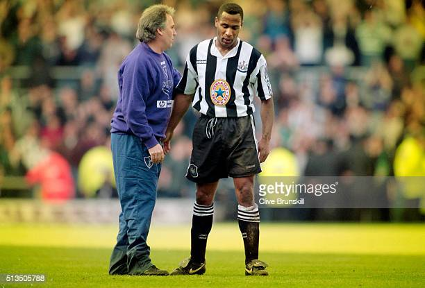 Spurs manager Gerry Francis consoles Newcastle striker Les Ferdinand after the 1-1 draw in the FA Carling Premiership match between Newcastle United...