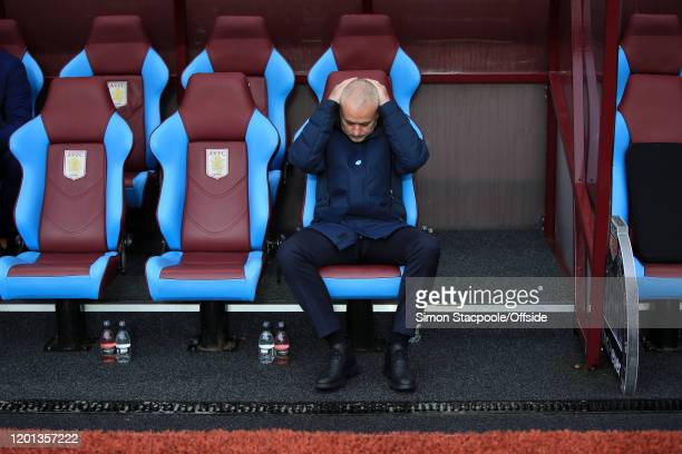Spurs manager Jose Mourinho looks dejected on the bench before the Premier League match between Aston Villa and Tottenham Hotspur at Villa Park on...