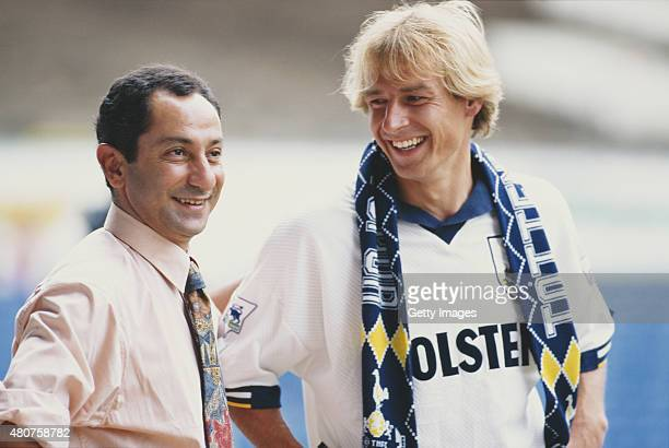 Spurs manager Osvaldo Ardiles greets new signing Jurgen Klinsmann to Tottenham Hotspur at White Hart Lane on August 4 1994 in London England