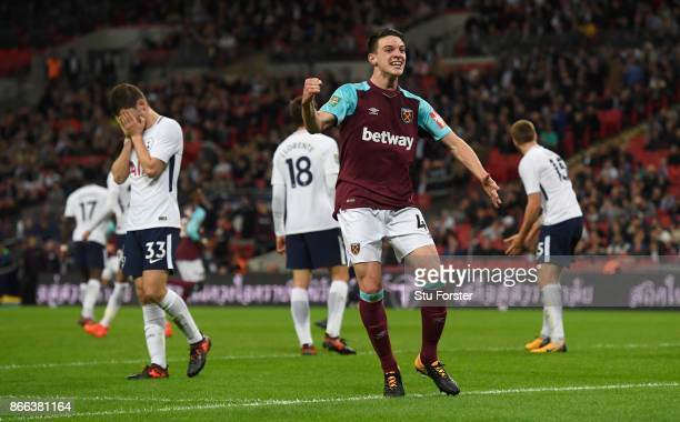 Spurs player Ben Davies reacts as West Ham defender Declan Rice celebrates the winning goal during the Carabao Cup Fourth Round match between...