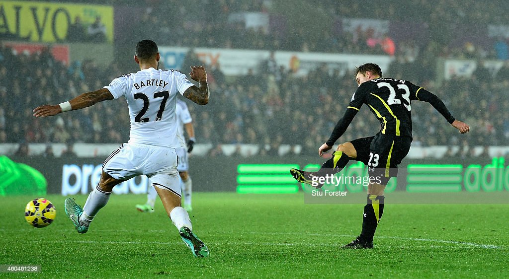 Spurs player Christian Eriksen fires in the second Spurs goal during the Barclays Premier League match between Swansea City and Tottenham Hotspur at Liberty Stadium on December 14, 2014 in Swansea, Wales.