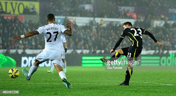 Spurs player Christian Eriksen fires in the second Spurs goal during the Barclays Premier League match between Swansea City and Tottenham Hotspur at...