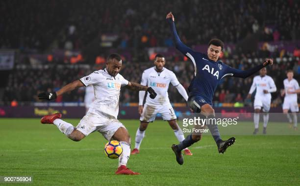 Spurs player Dele Alli attempts to block the shot of Jordan Ayew of Swansea during the Premier League match between Swansea City and Tottenham...