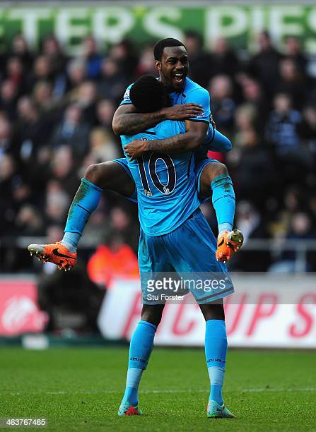 Spurs player Emmanuel Adebayor is congratulated by Danny Rose after scoring the third goal during the Barclays premier league match between Swansea...
