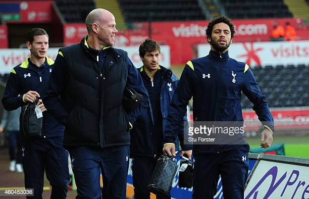 Spurs players Brad Friedel and Mousa Dembele share a joke as they enter the stadium before the Barclays Premier League match between Swansea City and...