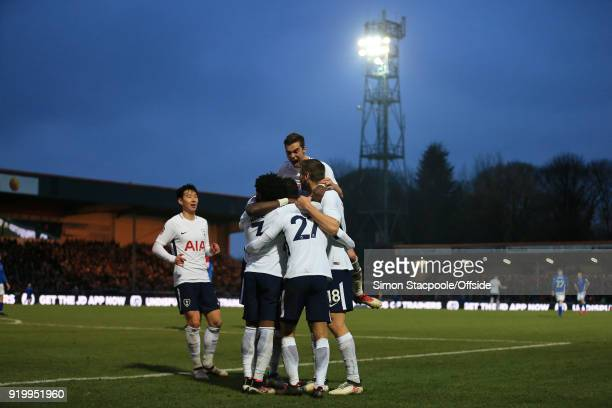 Spurs players celebrate their 1st goal during The Emirates FA Cup Fifth Round match between Rochdale AFC and Tottenham Hotspur at Spotland Stadium on...