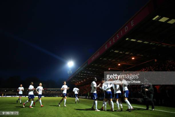 Spurs players celebrate their 2nd goal under the floodlights during The Emirates FA Cup Fifth Round match between Rochdale AFC and Tottenham Hotspur...
