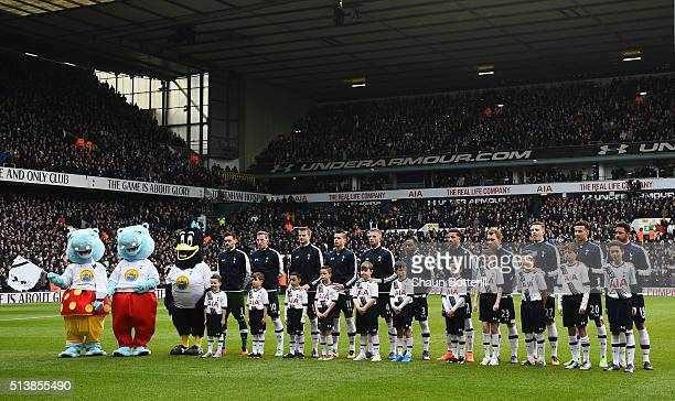 Spurs players line up with mascots prior to during the Barclays Premier League match between Tottenham Hotspur and Arsenal at White Hart Lane on...