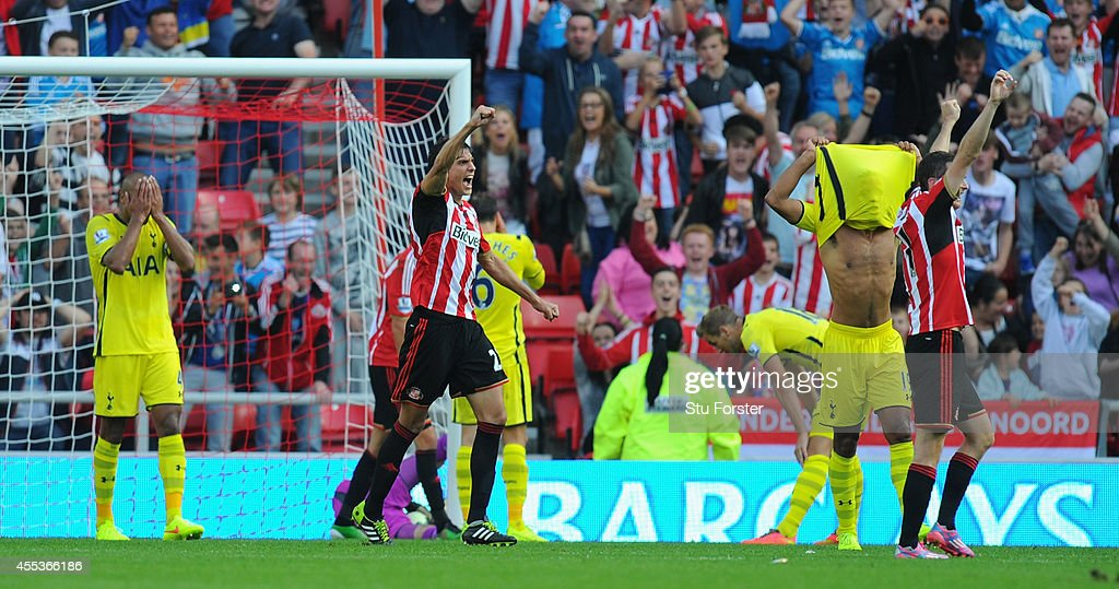 Spurs players react after player Harry Kane (hands on knees) scores the own goal for the second Sunderland goal during the Barclays Premier League match between Sunderland and Tottenham Hotspur at Stadium of Light on September 13, 2014 in Sunderland, England.