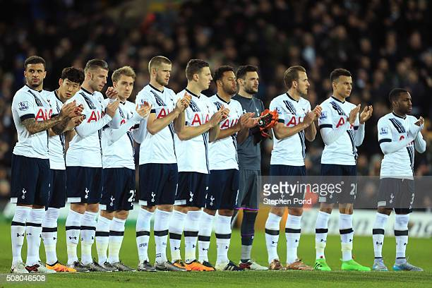 Spurs players stand for a minute's applause for former Norwich player Terry Bryceland prior to the Barclays Premier League match between Norwich City...