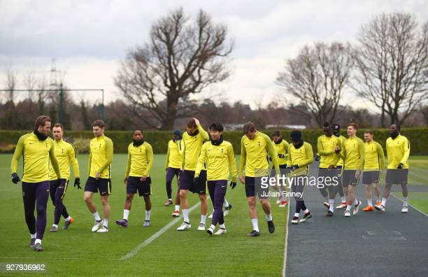Spurs players walk to the pitch during a Tottenham Hotspur training session on the eve of their UEFA Champions League match against Juventus at...