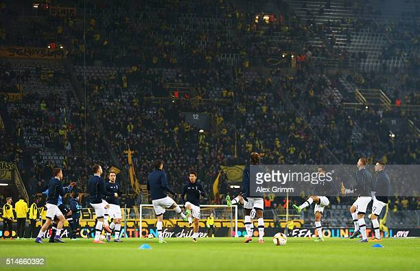 Spurs players warm up prior to the UEFA Europa League Round of 16 first leg match between Borussia Dortmund and Tottenham Hotspur at Signal Iduna...