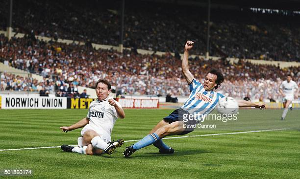 Spurs striker Clive Allen gets in a cross despite the attentions of Coventry defender Trevor Peake during the 1987 FA Cup Final between Coventry City...