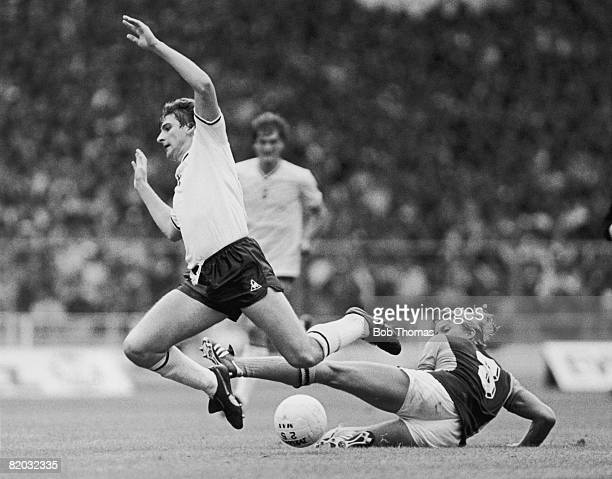 Spurs striker Mark Falco is brought down by Aston Villa's David Geddis during the FA Charity Shield at Wembley Stadium 22nd August 1981 The match was...