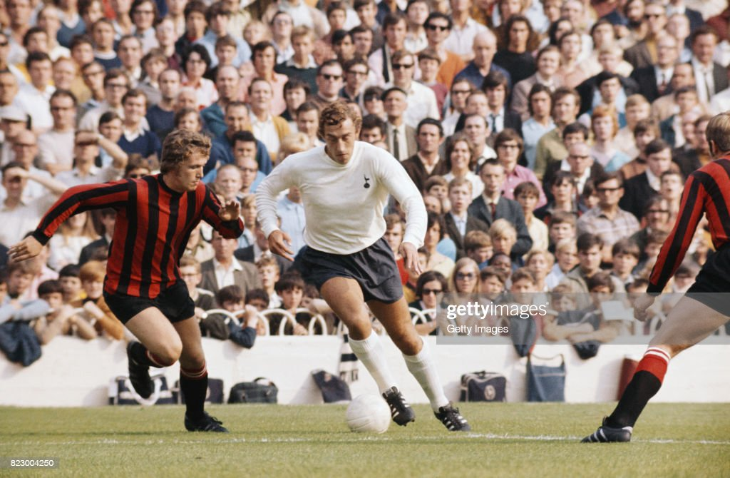 Spurs striker Martin Chivers (c) goes past Tony Towers of Manchester City during a First Division match between Tottenham Hotspur and Manchester City at White Hart Lane on September 26, 1970 in London, England.