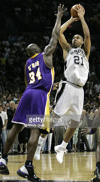 Spurs Tim Duncan makes a basket over Lakers Shaquille O'Neal to take the lead with 04 seconds left in the fourth quarter in Game 5 of the Western...
