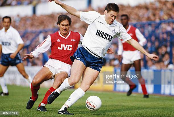 Spurs winger Chris Waddle holds off the challenge of Kenny Sansom during a First Division Match between Tottenham Hotspur and Arsenal at White Hart...