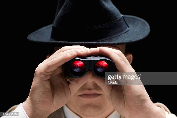 Spy Looking Through Binoculars