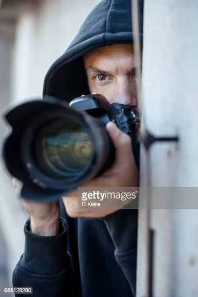 spy - stalker person stock photos and pictures