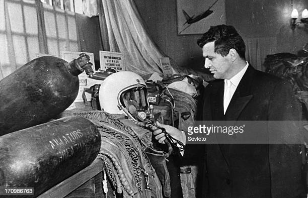 U2 spy plane pilot Francis Gary Powers poses with his flight helmet at exhibition of u2 plane wreckage and other evidence related to his moscow trial...