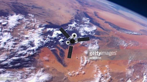 spy satellite orbiting earth. nasa public domain imagery - receiver stock pictures, royalty-free photos & images