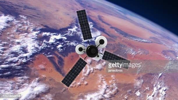 spy satellite orbiting earth. nasa public domain imagery - public domain stock pictures, royalty-free photos & images
