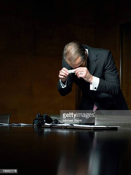spy taking photos with mini-camera in conference room - secret agent stock pictures, royalty-free photos & images