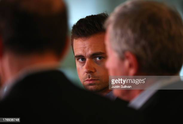 Sqaure CEO Jack Dorsey looks on as Senate Finance Committee Chairman Max Baucus and House Ways and Means Committee Chairman Dave Camp speak to...