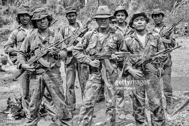 Squad of an elite battalion of the Sandinista Popular Army assembles in the jungle during combat operations against the U.S.-backed Contra rebels in...