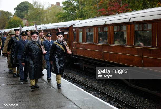 A squad of reenactors march down the platform at Pickering train station during the North Yorkshire Moors Railway 1940's Wartime Weekend event on...