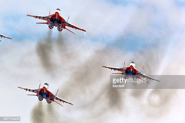 squad of russian fighters mig-29 flying in formation - russian military stock pictures, royalty-free photos & images