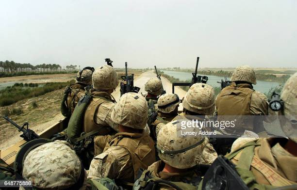 A squad of US marines rides a 7ton truck after being ambuhed several times by insurgents while on a 'movementtocontact mission in order to flush out...