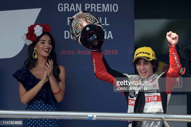 Squadra Corse's Italian rider Niccolo Antonelli celebrates on the podium after winning the Moto3 race of the Spanish Grand Prix at the Jerez Angel...