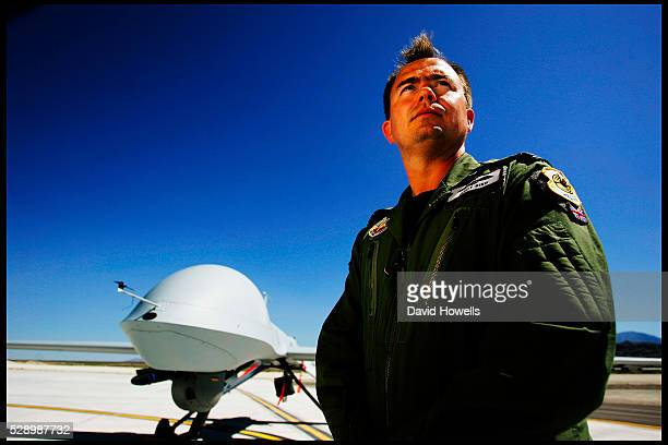 Squadron Leader Andy Bird with a predator UAV at Creech Air Force Base in Nevada The squadron flies Predator drone operations over Iraq and...