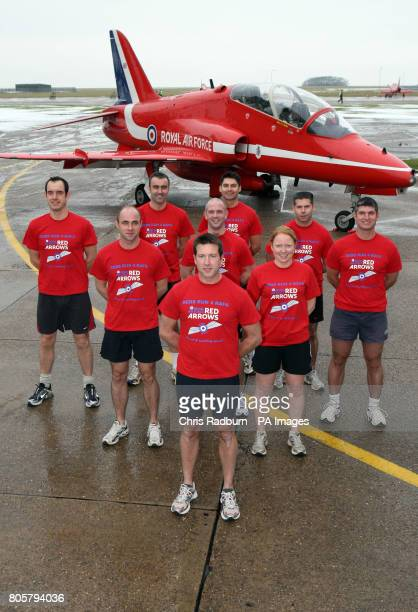 Squadron Leader Ben Murphy, Officer Commanding and Team Leader of The Red Arrows air display team poses with his team who will this year be running...