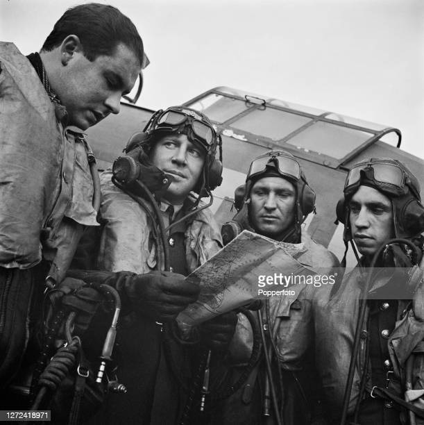 Squadron leader Ronald Gustave Kellett second from left consults a map with Polish Royal Air Force pilots from left Flying Officer Jerzy Jankiewicz...